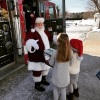 Santa Randy by fire truck
